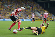 Alessandro Diamanti of Watford ® slides in to tackle Cedric Soares of Southampton. Barclays Premier League, Watford v Southampton at Vicarage Road in London on Sunday 23rd August 2015.<br /> pic by John Patrick Fletcher, Andrew Orchard sports photography.