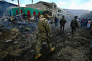 U.S. Marines Weapons Company 3/8th Marine Air Contingency MAGTAF, Camp Lejeune, N.C. patrol the streets of Port-Au-Prince Haiti on March 15, 2004. .
