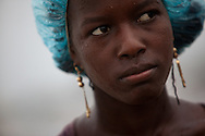 A young woman is pelted by rain as Hurricane Tomas passes through in the Jean-Marie Vincent tent camp near the Cite Soleil neighborhood in Port-au-Prince, Haiti.