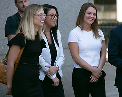 Annie Farmer (L) and Courtney Wild ( Far right), both women who say they were molested by Jeffrey Epstein when they were teenagers, faced the wealthy sex offender for the first time Monday, inside of a Manhattan courtroom. The two women, accompanied by one of attorney Brad Edwards' assistants (center), listen to their lawyers, Brad Edwards and David Boies talk to the media following Monday's hearing. Epstein's bond hearing will be continued Thursday, July 18, 2019 in New York City, NY, USA. Photo by Emily Michot/Miami Herald/TNS/ABACAPRESS.COM
