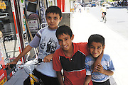 Turkey July 23 2011: Local boys pose for a photo in a street in Gaziantep. Copyright 2011 Peter Horrell