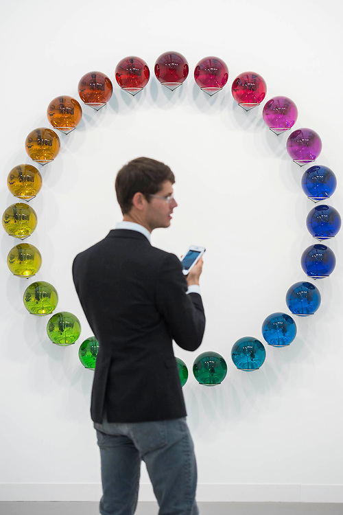 Polychromatic Attentio by Olafur Eliason in the Tanya Bonakdar gallery- Frieze London 2015, Regents Park, London. Frieze London is one of the few fairs to focus only on contemporary art and living artists. The exhibiting galleries represent the most 'exciting' contemporary galleries working today. The focus on living artists is also evident in the critically acclaimed Frieze Projects' programme. The fair presents a curated programme of talks, artists' commissions and film projects, many of which are interactive or performative and encourage visitors to engage with art and artists directly. The fair is open to the public 14–17 October.