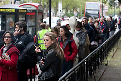 © licensed to London News Pictures. London, UK 06/05/2012. French nationals queueing outside the French Embassy in London to vote the second round of Presidential Elections, this noon (06/05/12). Photo credit: Tolga Akmen/LNP