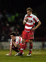 Photo: Jed Wee.<br /> Doncaster Rovers v Arsenal. Carling Cup. 21/12/2005.<br /> <br /> Doncaster's Ricky Ravenhill (R) and Sean McDaid cannot hide their disappointment after their penalty loss to Arsenal.