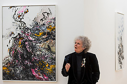 """© Licensed to London News Pictures. 14/10/2020. LONDON, UK. Artist Maggi Hambling poses with her work """"Covid Spring, 2020 at the preview of Maggi Hambling: 2020 at Malborough Gallery in Mayfair.  The exhibition of recent paintings coincides with Hambling's 75th Birthday and runs 15 October to 21 November 2020.  Photo credit: Stephen Chung/LNP"""