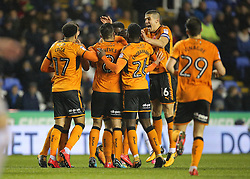 Wolves Conor Coady celebrates with Matt Doherty (obscured) as he celebrates scoring his sides second goal during the Sky Bet Championship match at the Madejski Stadium, Reading.
