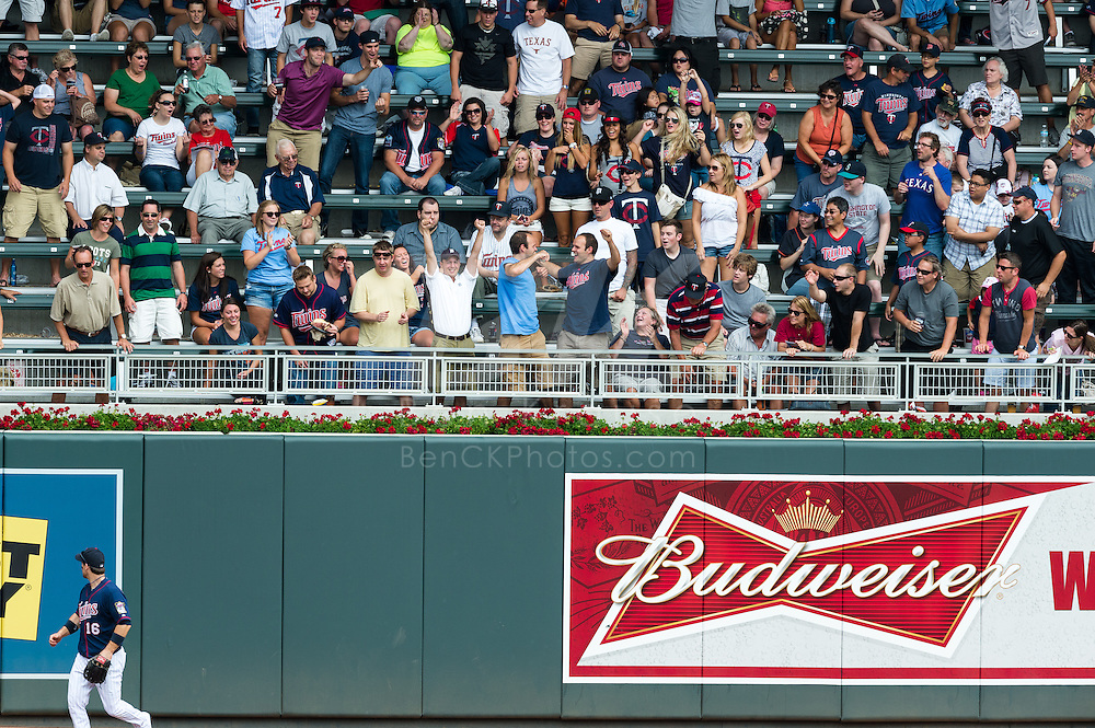 Fans celebrate after catching the home run ball of Delmon Young (21) of the Detroit Tigers during a game against the Minnesota Twins on August 15, 2012 at Target Field in Minneapolis, Minnesota.  The Tigers defeated the Twins 5 to 1.  Photo: Ben Krause