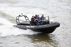 © Licensed to London News Pictures. 15/06/2016. London, UK. Police boats patrol the thames as the pro-Brexit campaign 'Fishermen for Leave', sail a flotilla of over 30 vessels up the Thames. The flotilla, including UKIP leader Nigel Farage, caused traffic issues in central London, as vessels travelled up the Thames for high tide and to coincide with the last Prime Minister's Questions before the EU referendum takes place on 23 June. Photo credit : Tom Nicholson/LNP