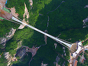 ZHANGJIAJIE, CHINA - JUNE 12: (CHINA OUT) <br /> <br /> Aerial view of the glass-bottomed bridge across the Zhangjiajie Grand Canyon on June 12, 2016 in Zhangjiajie, Hunan Province of China. World\'s longest and highest glass-bottomed bridge over the Zhangjiajie Grand Canyon was about to open. The bridge stretched 430 meters long, 6 meters wide and the biggest vertical drop was 1,430 meters under the path. <br /> ©Exclusivepix Media