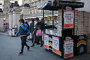 London Evening Standard newspapers feature the headline about Donald Trump's inauguration, on the day of he was made 45th US president, on 20th January, outside Charing Cross station, London borough of Westminster, England.