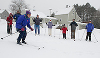 Bob Bolduc (third in from left) watches as Diane Nyren and her fellow students Oren Avrahami, Steve Birch, (Bob Bolduc) Debbie Birch, Ilan Avrahami, Tsachi Avrahami and Amanda Brunt take to the hills during week two of their cross country skiing lessons offered at Bolduc Park Saturday morning through the Gilford Parks and Recreation department.  (Karen Bobotas/for the Laconia Daily Sun)