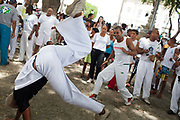 Men playing Capoeira in a square, outdoor, Every second 2nd Thursday in February thousands of people attend the Lavagem do Bonfim - The washing of Bonfim at the Iglesia do Bonfim - Church of Bonfim in Salvador de Bahia,