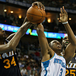 April 11, 2011; New Orleans, LA, USA; Utah Jazz small forward C.J. Miles (34)  blocks a shot by New Orleans Hornets point guard Chris Paul (3) during the second half at the New Orleans Arena. The Jazz defeated the Hornets 90-78.  Mandatory Credit: Derick E. Hingle