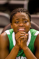 St. Mary's High School basketball player, Brijanee Moore, #14 cries after losing 53-51 to Archbishop Mitty in the girls DIV II CIF Norcal Championship game at Power Balance Arena Tuesday Jan 3, 2012. .Photo Brian Baer
