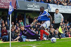 Steven Gillespie (ENG) of Bristol Rovers clings onto Bondz Ngala (ENG) of Portsmouth - Photo mandatory by-line: Rogan Thomson/JMP - 07966 386802 - 19/04/2014 - SPORT - FOOTBALL - Fratton Park, Portsmouth - Portsmouth FC v Bristol Rovers - Sky Bet Football League 2.