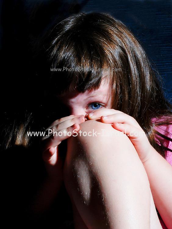 Young girl afraid of household violence