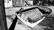 """""""Free Boat"""" sign on old speed boat at side of street in Port Colborne, Ontario, Canada"""