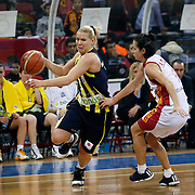 Fenerbahce's Anete JEKABSONE (L) during their EuroLeague Women Basketball League game 2 match Galatasaray MP between Fenerbahce at the Abdi Ipekci Arena in Istanbul at Turkey on Friday, February, 05, 2011. Photo TURKPIX