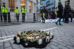 London, UK. 21st December, 2018. Environmental campaigners from Extinction Rebellion prepare to remember the 27 people found burnt alive in the Greek village of Mati after July's wildfires during a protest outside Broadcasting House against the lack of coverage by the BBC of the climate change crisis.
