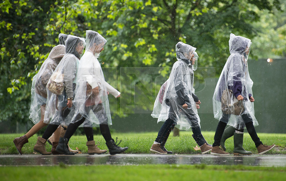 © London News Pictures. 07/07/2012. Rain soaked arriving for Wireless Festival in Hyde Park, London on July 7, 2012. The environment agency has issued severe weather warnings with three inches of rain falling in 24 hours in some parts.  Photo credit: Ben Cawthra/LNP.