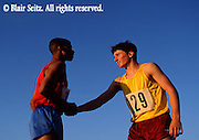 Outdoor recreation, Competitive Running, Track and Field, High School Runners Winning Track Meet, Handshake with Loser,