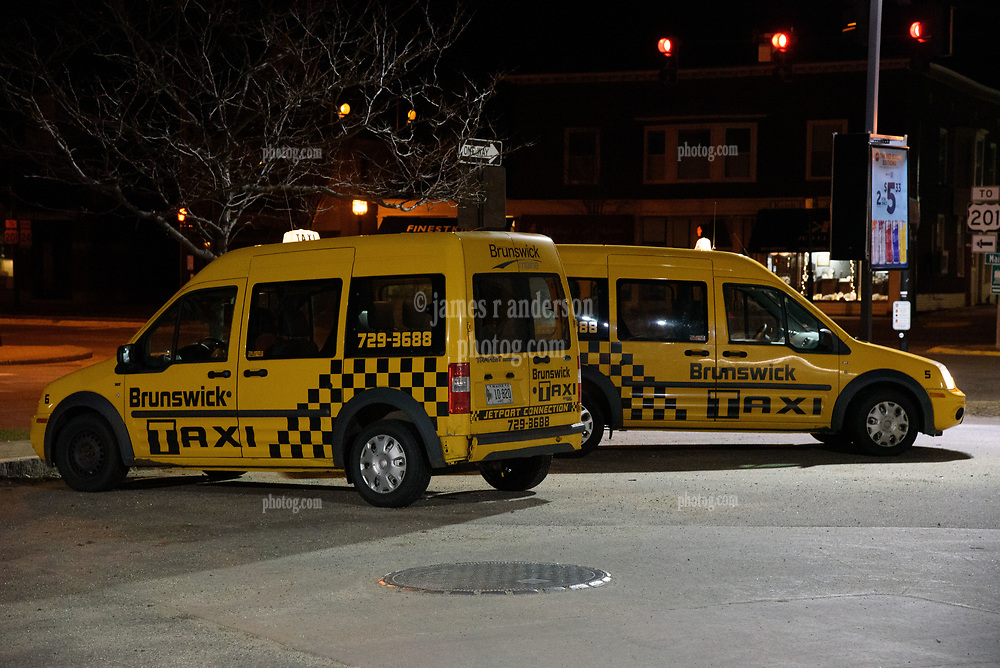 Taxis Standing in Wait on a Brunswick Maine Corner. Friday Night 25 April 2015