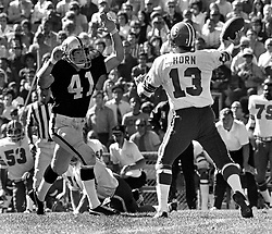 Denver Bronco QB Don Horn,rushed by Oakland Raider linebacker Phil Villapiano. (1973 photo/Ron Riesterer)