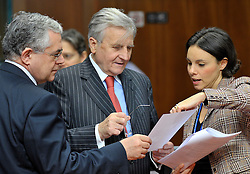 Jean-Claude Trichet, president of the European Central Bank, center, speaks with Lucas D. Papademos, vice-president of the European Central Bank, left, and Paola Del Favero, senior economist with the European Central Bank, during the ECOFIN meeting of finance ministers from the European Union, at the EU Council headquarters on Wednesday, Dec. 2, 2009, in Brussels, Belgium. (Photo © Jock Fistick)
