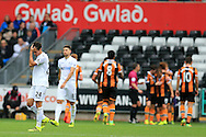 Jack Cork of Swansea city (l) is dejected as Hull city players celebrate their 2nd goal. Premier league match, Swansea city v Hull city at the Liberty Stadium in Swansea, South Wales on Saturday 20th August 2016.<br /> pic by Andrew Orchard, Andrew Orchard sports photography.