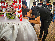 04 NOVEMBER 2014 - YANGON, MYANMAR: A Burmese Shia Muslim in Mogul Mosque in Yangon kisses the shrine representing Hussein's grave on Ashura. Ashura, commemorates the death of Hussein ibn Ali, the grandson of the Prophet Muhammed, in the 7th century. Hussein ibn Ali is considered by Shia Muslims to be the third imam and the rightful successor of Muhammed. He was killed at the Battle of Karbala in 610 CE on the 10th day of Muharram, the first month of the Islamic calendar. According to Myanmar government statistics, only about 4% of the population is Muslim. Many Muslims have fled Myanmar in recent years because of violence directed against Burmese Muslims by Buddhist nationalists.     PHOTO BY JACK KURTZ