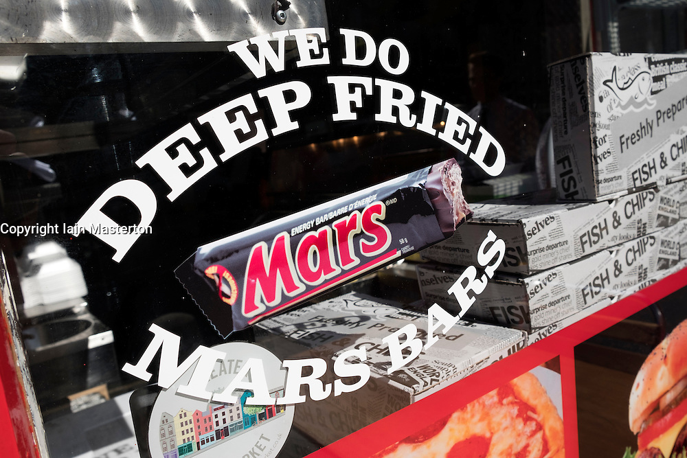 Cafe with sign offering Deep Fried Mars Bars in Edinburgh Scotland,United Kingdom