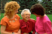 Granddaughters ages 26 and 28 with grandmother age 91 talking.  WesternSprings Illinois USA