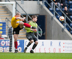 Falkirk's Michael McGovern tackled by Partick Thistle's Alan Archibald..Falkirk 1 v 1 Partick Thistle, 10/3/2012..©Michael Schofield.
