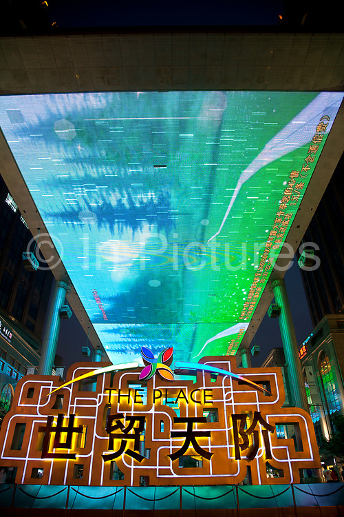 The Place is a new shopping street located in Beijing CBD. The huge overhead LCD screen designed by Jeremy Railton from Hollywood, is 250m long 30m wide. The Beijing Central Business District, or CBD is the primary area of finance, media, and business services in Beijing, China. It occupies 4km2 of the Chaoyang District on the east side of the city. As the city is becoming one of the most important international financial centers in China so the CBD grows in height as skyscrapers rise into the sky.