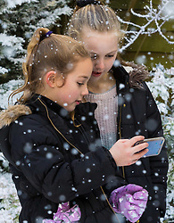Tunbridge Wells, December 16 2017. Winner of the TK Maxx White Christmas promotion enjoy a day of fun in the snow, after aunt Helen Haggertay found one of the 'snow globes' in TK Maxx in Tunbridge Wells and gifted it to her sister Louise and niece Sofia Migliaccio. An exciting day ensued after several tons of snow were delivered BY TK Maxx and friends arrived to enjoy the day. PICTURED: Sofia , 9 and best friend Dixie, 10.
