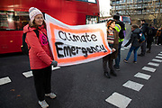 Climate change activists from the Extinction Rebellion group block roads in central London at Elephant and Castle in protest that the government is not doing enough to avoid catastrophic climate change and to demand the government take radical action to save the planet, on 21st November 2018 in London, England, United Kingdom. Extinction Rebellion is a climate change group started in 2018 and has gained a huge following of people committed to peaceful protests.