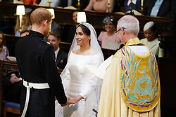 Prince Harry and Meghan Markle in St George's Chapel at Windsor Castle during their wedding service, conducted by the Archbishop of Canterbury Justin Welby.