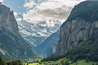 "It's difficult to find a village with a more beautiful view than that of Lauterbrunnen, Switzerland. Set in a deep valley in the Bernese Alps, the name of the town means ""many fountains."" There are said to be 72 waterfalls cascading over the sheer cliffs into the valley, and it seems the sound of falling water is never out of earshot. At the head of the valley is Grosshorn which was covered by a fresh snowfall the day before."