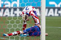 Atletico de Madrid´s Mandzukic gets hurt with Griezmann during 2014-15 La Liga match at Vicente Calderon stadium in Madrid, Spain. January 03, 2015. (ALTERPHOTOS/Victor Blanco)