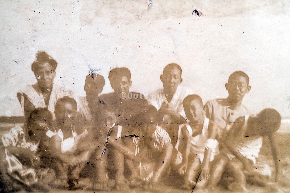 deteriorating group portrait Japan ca 1940s
