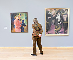 Woman looking at paintings at at the Museum Kunst Palast or Art Palace Museum in Dusseldorf in Germany