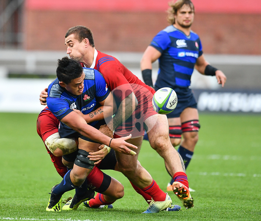 Hendrik Tui of Japan offloads in the tackle<br /> <br /> Photographer Craig Thomas<br /> <br /> Japan v Russia<br /> <br /> World Copyright ©  2018 Replay images. All rights reserved. 15 Foundry Road, Risca, Newport, NP11 6AL - Tel: +44 (0) 7557115724 - craig@replayimages.co.uk - www.replayimages.co.uk