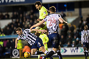 Millwall defender Shaun Hutchinson (4), Peterborough United defender Ryan Tafazolli (5), Millwall defender Jake Cooper (24) during the EFL Sky Bet League 1 match between Millwall and Peterborough United at The Den, London, England on 28 February 2017. Photo by Sebastian Frej.