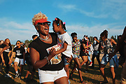 LaTonya Rogers dances as she holds Charleena Lyles' daughter Za'layah Camphor, 5, during a remembrance event on the one-year anniversary of Lyles' death, Tuesday, June 18, 2018 at Magnuson Park.  Lyles was killed one year ago by Seattle Police officers in her apartment after she called them for assistance.