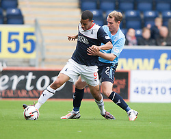 Falkirk's Phil Roberts and Dundee's Gary Irvine.<br /> Falkirk 3 v 1 Dundee, 21/9/2013.<br /> ©Michael Schofield.