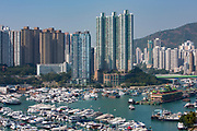 (A view of the Hong Kong skyline overlooking boats in Aberdeen Bay during the day in Hong Kong. The large boat on the right holds the Jumbo Floating restaurants.  photo by Andrew Aitchison / In pictures via Getty Images)