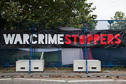 A banner is pictured draped over temporary fencing around ExCeL London in advance of the DSEI 2021 arms fair on 12th September 2021 in London, United Kingdom. Activists from a range of different groups continue to protest outside the venue for one of the world's largest arms fairs.