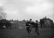 The giant Marques, left, gives a powerfull hand off to Risman, the speedy outside half, during English team practice at College Park, Friday 13th February, 1959,..Irish Rugby Football Union, Ireland v England, Five Nations, English team practice, College Park, Dublin, Ireland, Friday 13th February, 1959,.13.2.1959, 2.13.1959,..English Team, ..J G G Hetherington, Wearing number 1 English jersey, Full Back, Northhampton Rugby Football Club, Northhampton, England, ..P H Thompson, Wearing number 5 English jersey, Left Wing, Waterloo Rugby Football Club, Liverpool, England,..J Butterfield, Wearing number 4 English jersey, Captain of the English team, Left Centre, Northhampton Rugby Football Club, Northhampton, England, ..M S Phillips, Wearing number 3 English jersey, Right centre, Oxford University Rugby Football Club, Oxford, England,..P B Jackson, Wearing number 2 English jersey, Right Wing, Coventry Rugby Football Club, Coventry, England, ..A B W Risman, Wearing number 6 English jersey, Outside Half, Manchester University Rugby Football Club, Manchester, England,..S R Smith, Wearing number 7 English jersey, Scrum Half, Cambridge University Rugby Football Club, Cambridge, England,..L H Webb, Wearing number 8 English jersey, Forward, Bedford Rugby Football Club, Bedford, England,..J A S Wackett, Wearing number 9 English jersey, Forward, Rosslyn Park Rugby Football Club, London, England,..G J Bendon, Wearing number 10 English jersey, Forward, Wasps Rugby Football Club, London, England,..R W D Marques, Wearing number 11 English jersey, Forward, Harlequins Rugby Football Club, London, England,..J D Currie, Wearing number 12 English jersey, Forward, Harlequins Rugby Football Club, London, England,..A J Herbert, Wearing number 13 English jersey, Forward, Wasps Rugby Football Club, London, England,..A Ashcroft, Wearing number 14 English jersey, Forward, Waterloo Rugby Football Club, Liverpool, England,..J W Clements, Wearing number 15 English jersey, Forward, Old Cranleighans