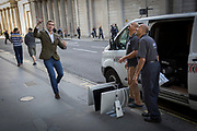 Delivery men organise Apple Mac screens in the street, on 27th October 2017, in the City of London, England.