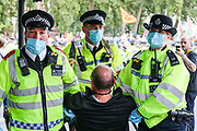Police officers started to arrest Extinction Rebellion climate change protestors in Parliament Square, central London on Tuesday, Sept 1, 2020. (VXP Photo/ Vudi Xhymshiti)